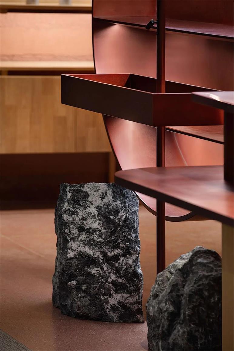 茶文化体验馆石材与金属材质碰撞设计