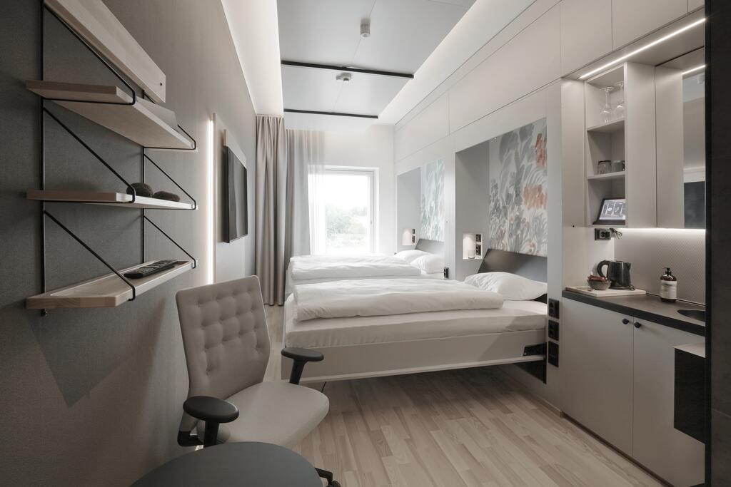 酒店房间隐藏式的家具设计